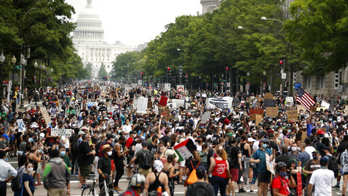 Demonstrators walk on Pennsylvania Avenue as they protest, Saturday, June 6, 2020, in...