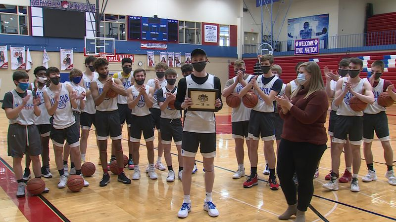 Josh Dix is awarded the Athlete of the Week at Abraham Lincoln High School in Council Bluffs on...