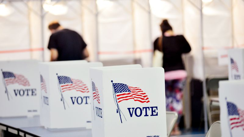 In this Sept. 8, 2020 photo, voting booths are kept socially distant at the Chesterfield, N.H....