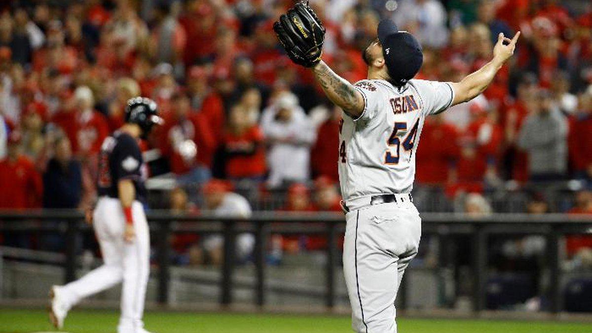 Houston Astros relief pitcher Roberto Osuna celebrates their teams win against the Washington...