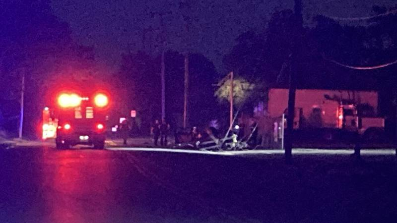 A car crashed into a pole at Ames Ave. and Commercial Ave.