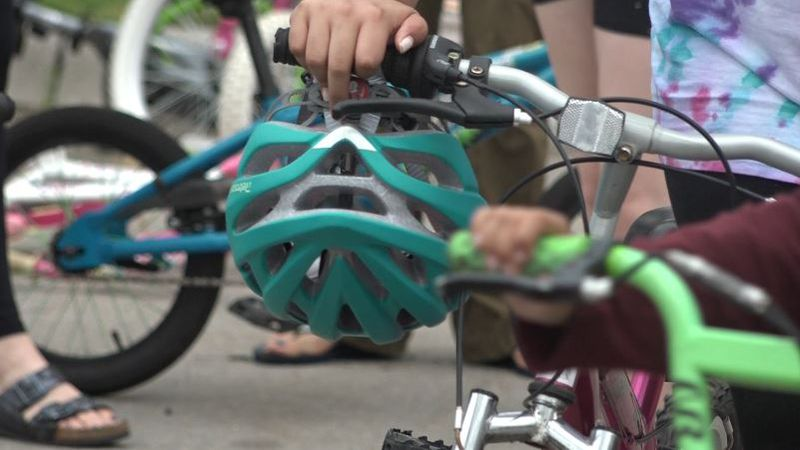 Omaha Fire Department and community partners gave away 150 bikes and helmets to kids and their...