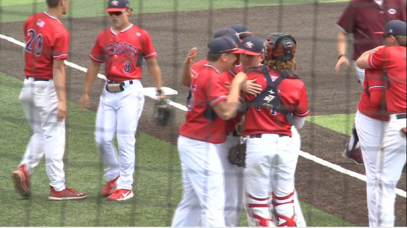 Millard South's baseball team celebrates after a first round win over Columbus in the 2021...
