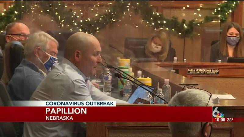 Papillion City Council members listen to public comment on proposed mask ordinance during their...