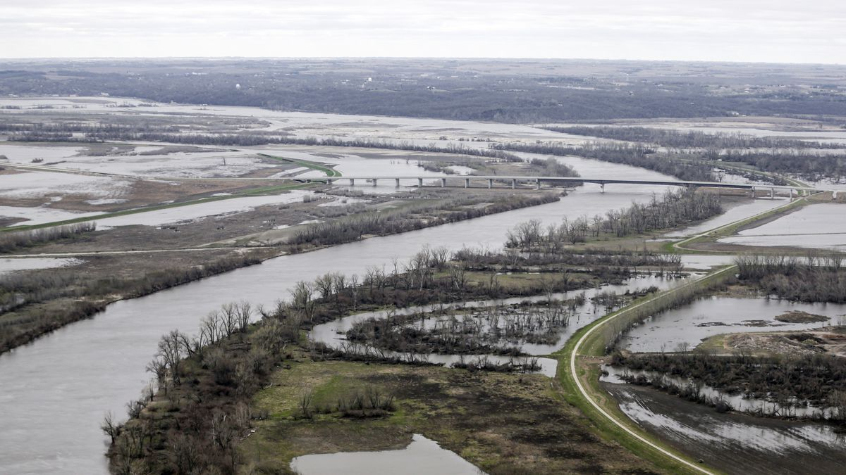 In this April 2019 file photo, the Highway 34 bridge that spans the Missouri River sits among...