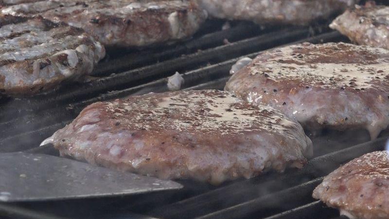 Pork burgers get grilled up at Open Door Mission, Oct. 15, 2020