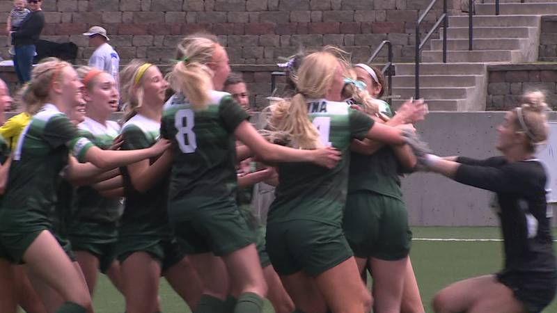 The Gretna girls soccer team celebrates after beating Lincoln East in a shootout in the Class A...