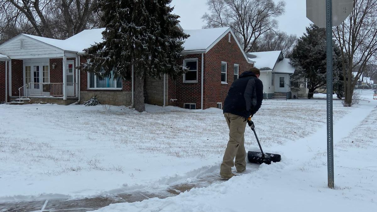 Justin Kyser is the founder of Scooped, a snow removal company that works in a similar way to Uber or Lyft. On Friday, Jan. 17, 2020, he was shoveling free of charge. (Tara Campbell / WOWT)