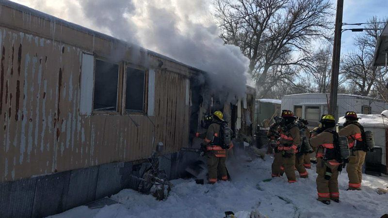Emergency crews on the scene of a trailer home fire at 2545 Theresa Street in Lincoln on...