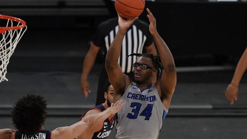 Creighton's Denzel Mahoney (34) shoots over Connecticut's Andre Jackson (44) during the second...