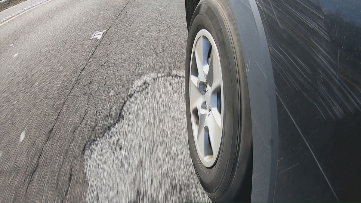 Car drives over pothole once repaired on road (Source: WVLT)