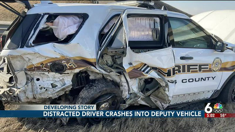 Distracted driver crashes into deputy vehicle