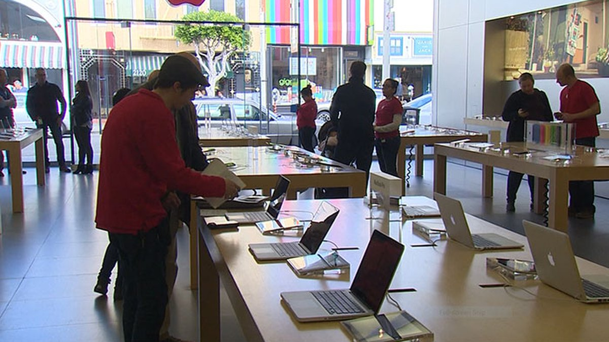 FILE PHOTO - Apple CEO Tim Cook says the tech giant's retail operation outside of...