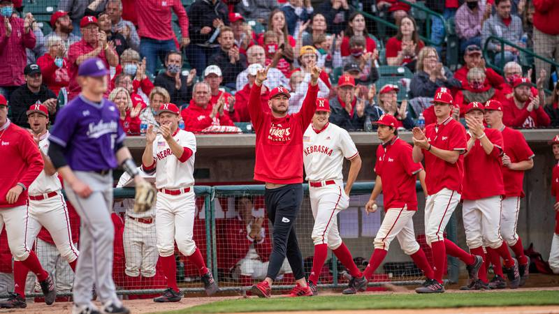 Huskers celebrate in the dugout